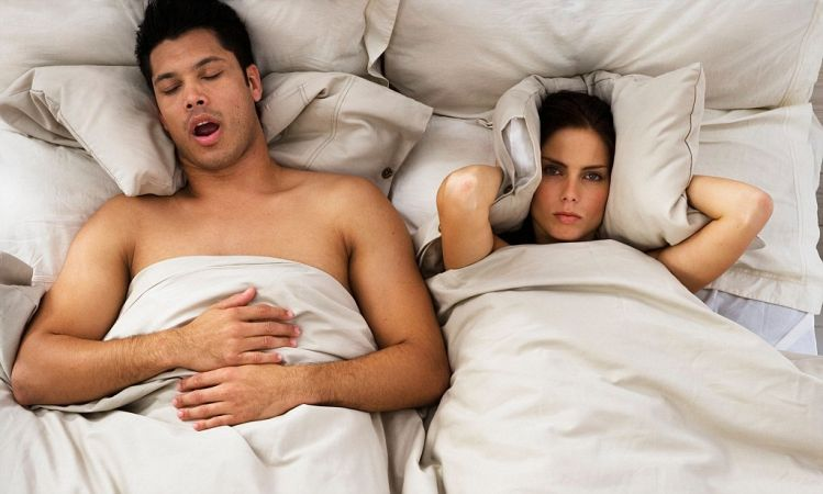ATF4N5 Woman Trying to Sleep While Man Snores